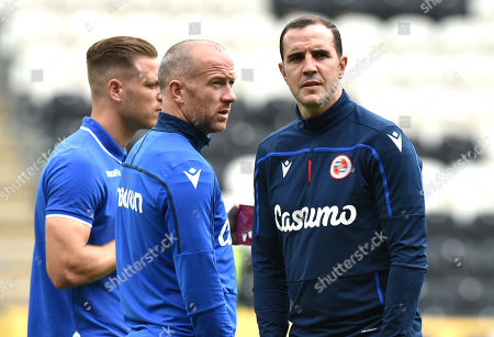 First Team coach John O'Shea and Charlie Adam of Reading on the pitch