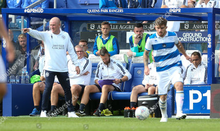 Mark Warburton - Manager of QPR (L) points as Ryan Manning of QPR takes the ball forward