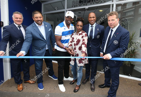 Kiyan Prince's parents (Mark Prince in the Cap) cut the ribbon as Loftus Road is renamed The Kiyan Prince Foundation Stadium with Andy Sinton, Ruben Gnanalingam, Les Ferdinand & Lee Hoos