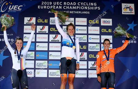 Winner Netherlands Ellen van Dijk (C), next to secong placed Germany's Lisa Klein (L) and third palced Netheralnds Lucinda Brand, on the podium during the Road Cycling European Championships in Alkmaar, the Netherlands, 08 August 2019. Van Dijk has become European time trial champion for the fourth time in a row.