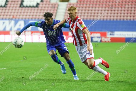 Dujon Sterling of Wigan Athletic and Sam Clucas of Stoke City