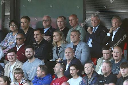Phil Neville, Paul Scholes, Nicky Butt, Sir Alex Ferguson, Gary Neville, Sky Sport's Laura Woods, Paul Robinson and Mike Phelan watch on