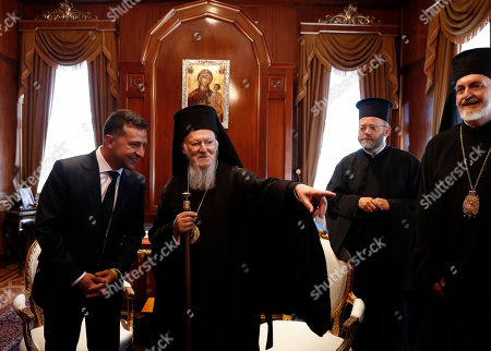 Stock Image of Ukraine's President Volodymyr Zelensky (L) meets with Ecumenical Patriarch Bartholomew I (2-L), spiritual leader of Greek Orthodox at St George Church in Istanbul, Turkey, 08 August 2019. Zelensky began on 07 August a two-day visit to Turkey.