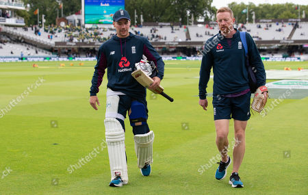 England's Rory Burns & Paul Collingwood walk across the outfield during the rain delay