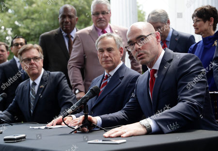 Greg Abbott, Dan Patrick, Dennis Bonnen. Speaker of the House Dennis Bonnen, seated right, with Governor Greg Abbott, seated center, and Lt. Governor Dan Patrick, seated left, and other law makers attend a joint press conference to discuss teacher pay and school finance at the Texas Governor's Mansion in Austin, Texas, in Austin
