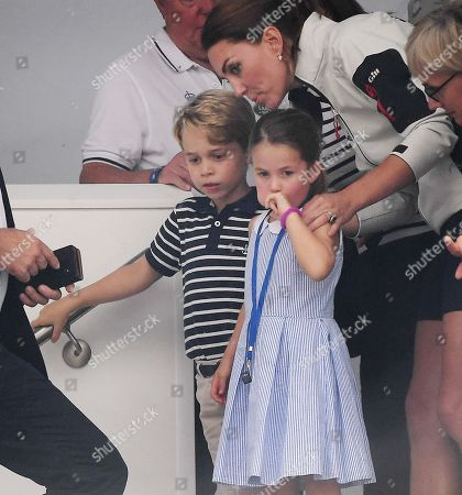 (L-R) Britain's Prince George, Princess Charlotte and their mother, Catherine, Duchess of Cambridge during the King's Cup sailing regatta off the Isle of White, Britain, 08 August 2019. The Duke and Duchess of Cambridge took part in the race.