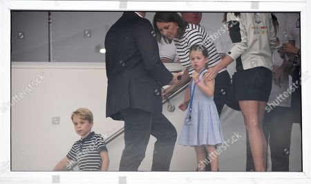 Britain's Prince George (L), Princess Charlotte (C, front) and their grandmother, Carole Middleton (C, back) during the King's Cup sailing regatta off the Isle of White, Britain, 08 August 2019. The Duke and Duchess of Cambridge took part in the race.