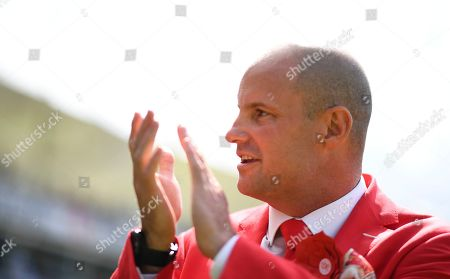 Andrew Strauss in red on a day dedicated to his late wife Ruth