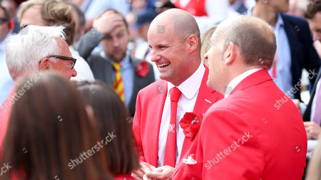 Andrew Strauss smiles and laughs  - dressed in red for the  Ruth Strauss Foundation