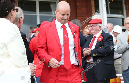 Andrew Strauss comes out at Lord's to applause, dressed in red  in honour of his wife Ruth and the Ruth Strauss Foundation.