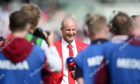 Andrew Strauss smiles and laughs  - dressed in red for the  Ruth Strauss Foundation  - with Sky Sports