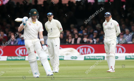 England's Jonny Bairstow (WK) & England's Joe Root (Captain) look bemused as they watch Steve Smith of Australia go through his fidgeting, frenetic routine before and after batting