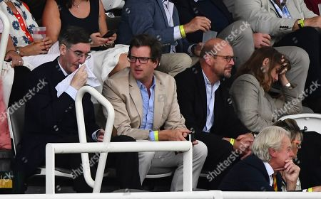 Jacob Rees-Mogg wipes his face as he attends day 4 with food critic William Sitwell