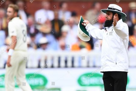 Aleem Dar signals a very late wide in the first over bowled by England's Stuart Broad