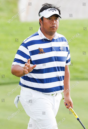 Stock Photo of Kiradech Aphibarnrat of Thailand after a birdie on the 3rd hole during the first round of the Northern Trust golf tournament at the Liberty National Golf Club in Jersey City, New Jersey, USA, 08 August 2019. The tournament, which is the first event of the PGA Tour?s FedEx Cup Playoffs, will be held from 08 August to 11 August.