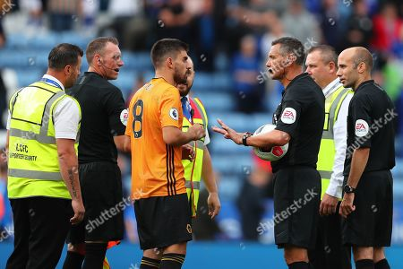 Referee, Andre Marriner ushers Ruben Neves of Wolverhampton Wanderers away after the match - Leicester City v Wolverhampton Wanderers, Premier League, King Power Stadium, Leicester, UK - 11th August 2019 Editorial Use Only - DataCo restrictions apply