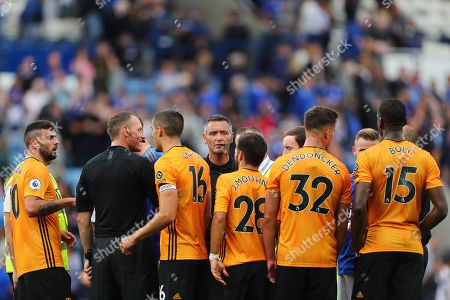 Referee, Andre Marriner surrounded by Wolverhampton Wanderers players following the match - Leicester City v Wolverhampton Wanderers, Premier League, King Power Stadium, Leicester, UK - 11th August 2019 Editorial Use Only - DataCo restrictions apply
