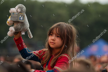 A girl with a soft toy watches the presentation of British primatologist Dr. Jane Goodall, founder of the Jane Goodall Institute and UN Messenger of Peace, at the 27th Sziget (Island) Festival on Shipyard Island, Northern Budapest, Hungary, 08 August 2019. The festival is one of the biggest cultural events of Europe offering art exhibitions, theatrical and circus performances and above all music concerts in seven days.