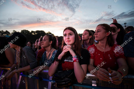 Stock Picture of Festival-goers attend the concert of English singer and songwriter Richard Ashcroft (unseen) at the 27th Sziget (Island) Festival on Shipyard Island, Northern Budapest, Hungary, 08 August 2019. The festival is one of the biggest cultural events of Europe offering art exhibitions, theatrical and circus performances and above all music concerts in seven days.