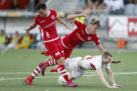 Thun's Nikki Havenaar (R) and Thun's Sven Joss (L) in action against Spartak's Andre Schurrle (C) during the UEFA Europa League third qualifying round, first leg, soccer match between FC Thun and Spartak Moscow at the Stockhorn Arena in Thun, Switzerland, 08 August 2019.