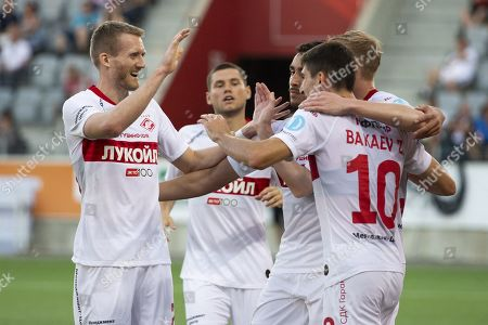 Stock Image of Spartak's Zelimkhan Bakaev (R, front) celebrates with teammate Andre Schurrle (L) after scoring the 2-3 goal during the UEFA Europa League third qualifying round, first leg, soccer match between FC Thun and Spartak Moscow at the Stockhorn Arena in Thun, Switzerland, 08 August 2019.