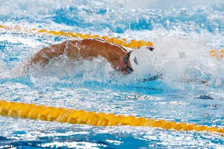 Nathan Adrian competes in a men's swimming 100m freestyle at the Pan American Games in Lima, Peru