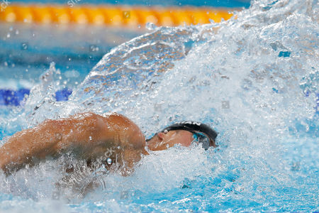 Nathan Adrian of the United States competes to win the silver medal for men's swimming 100m freestyle at the Pan American Games in Lima, Peru