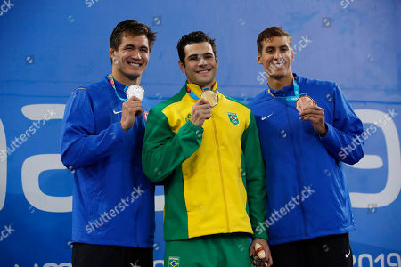 Gold medalist Marcelo Chierighini of Brazil, center, silver medalist Nathan Adrian, left, and bronze medalist Michael Chadwick, both of the United States, pose with their medals for the men's swimming 100m freestyle at the Pan American Games in Lima, Peru