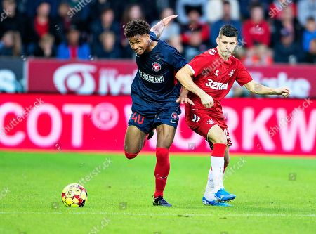 Midtjylland's Jens-Lys Cajuste (L) in action against Rangers' Jordan Jones (R) during the UEFA Europa League third qualifying round, first leg soccer match between FC Midtjylland and Glasgow Rangers in Herning, Denmark, 08 August 2019.