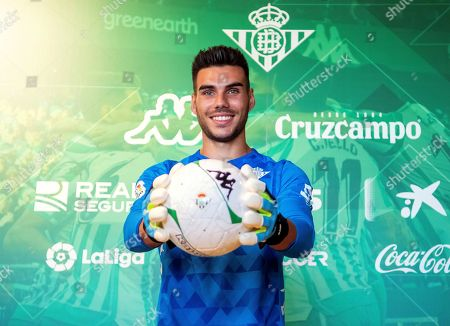 Real Betis' new Spanish goalkeeper Dani Martin (C) poses for photographers during his presentation as new player of the Spanish La Liga soccer club in Seville, Spain, 08 August 2019.