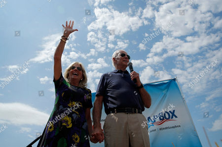 Stock Picture of Democratic presidential candidate former Vice President Joe Biden and his wife Jill Biden stand on a stage at the Iowa State Fair, in Des Moines, Iowa