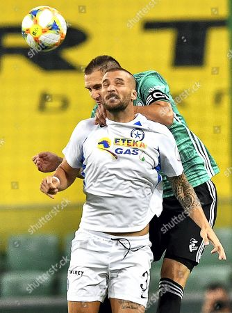 Artur Jedrzejczyk (back) of Legia Warsaw in action against Apostolos Vellios (front) of Atromitos during the UEFA Europa League third qualifying round, first leg soccer match between Legia Warsaw and Atromitos Athens in Warsaw, Poland, 08 August 2019.