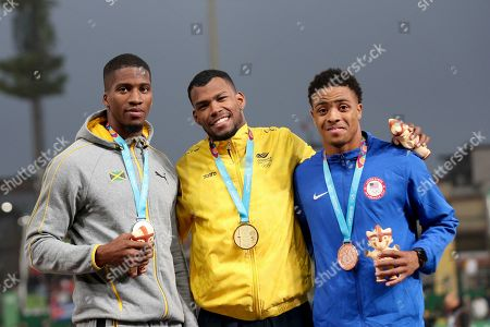 From left to right, silver medalist Demish, Gaye of Jamaica, gold medalist Anthony Zambrano of Colombia and bronze medalist Justin Robinson of United States stand on the podium for the men's 400m during the athletics at the Pan American Games in Lima, Peru