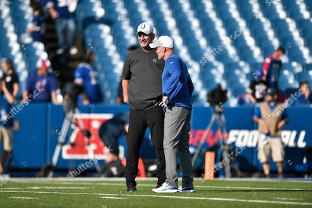 Indianapolis Colts head coach Frank Reich, left, and Buffalo Bills head coach Sean McDermott talks before an NFL pre-season football game, in Orchard Park, N.Y