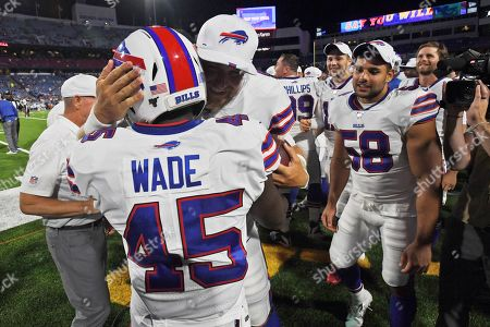 Buffalo Bills' Christian Wade (45) celebrates his touchdown with teammates during the second half of an NFL preseason football game against the Indianapolis Colts, in Orchard Park, N.Y