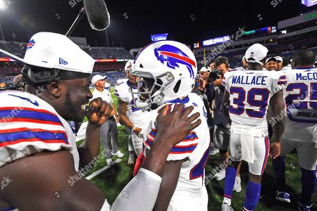 Buffalo Bills' Christian Wade (45), center, celebrates his touchdown with teammates during the second half of an NFL preseason football game against the Indianapolis Colts, in Orchard Park, N.Y