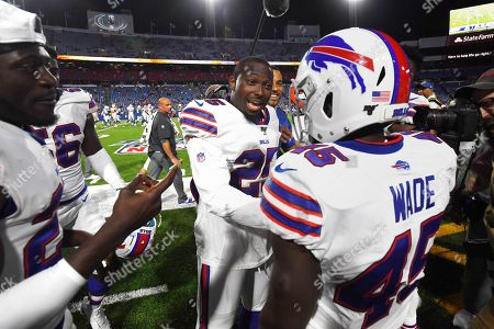 Buffalo Bills' LeSean McCoy, center, celebrates with Christian Wade (45) after Wade scored a touchdown during the second half of an NFL preseason football game against the Indianapolis Colts, in Orchard Park, N.Y