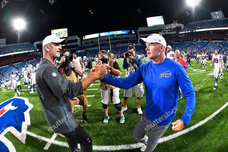 Indianapolis Colts head coach Frank Reich, left, shakes hands with Buffalo Bills head coach Sean McDermott after an NFL preseason football game, in Orchard Park, N.Y. The Bills defeated the Colts 24-16