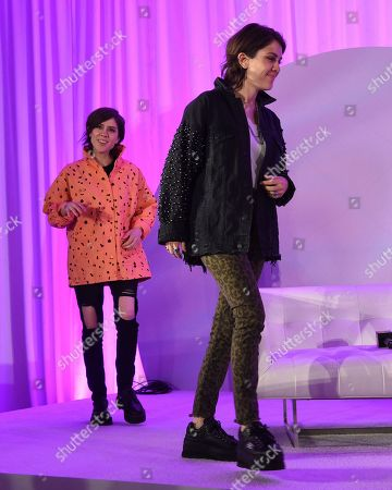 "Sara Quin, Tegan Quin. Sara Quin, left, and Tegan Quin, of Tegan and Sara, participate in the ""Queer Headliners 2019"" panel at Billboard and THR's Pride Summit, in West Hollywood, Calif"