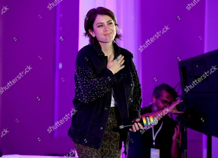 "Tegan Quin, of Tegan and Sara, walks on stage before the ""Queer Headliners 2019"" panel at Billboard and THR's Pride Summit, in West Hollywood, Calif"