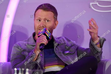 """Shane McAnally speaks during the """"They/Them Write The Songs"""" panel at Billboard and THR's Pride Summit, in West Hollywood, Calif"""