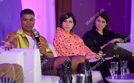 "Sara Quin, Tegan Quin. ILoveMakonnen, from left, speaks as Sara Quin and Tegan Quin, of Tegan and Sara, look on in the ""Queer Headliners 2019"" panel at Billboard and THR's Pride Summit, in West Hollywood, Calif"