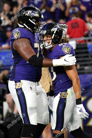 Baltimore Ravens wide receiver Willie Snead, right, is congratulated by offensive tackle Ronnie Stanley after scoring on a pass from quarterback Lamar Jackson during the first half of an NFL football preseason game against the Jacksonville Jaguars, in Baltimore