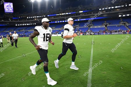 Jacksonville Jaguars wide receiver Chris Conley (18) and quarterback Nick Foles (7) run off the field after an NFL football preseason game against the Baltimore Ravens, in Baltimore. The Ravens won 29-0
