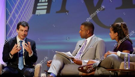 Stock Image of Democratic presidential candidate Pete Buttigieg, left, speaks during the annual National Association of Black Journalists, in Aventura, Fla. To the right are moderators Craig Melvin with MSNBC and Alexi McCammond with Axios