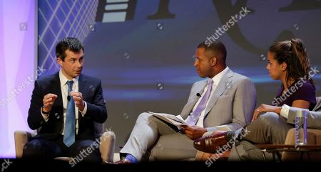 Stock Photo of Democratic presidential candidate Pete Buttigieg, left, speaks during the annual National Association of Black Journalists, in Aventura, Fla. To the right are moderators Craig Melvin with MSNBC and Alexi McCammond with Axios