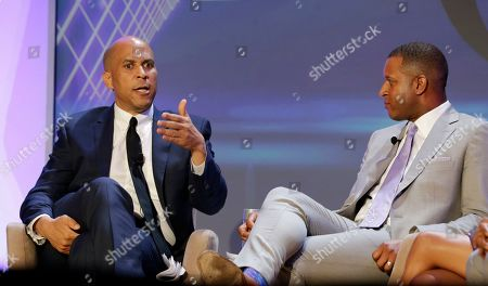 Stock Picture of Cory Booker, Craig Melvin. Democratic presidential candidate Sen. Cory Booker (D-NJ), left, gestures as moderator Craig Melvin listens, during the annual National Association of Black Journalists Conference, in Aventura, Fla