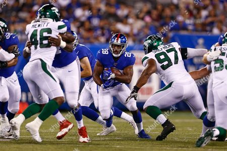 New York Jets' Nathan Shepherd (97) closes in on New York Giants' Paul Perkins (28) during the first half of a preseason NFL football game, in East Rutherford, N.J