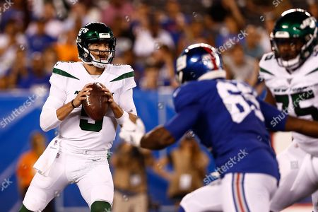 New York Jets quarterback Davis Webb (5) looks to pass during the second half of a preseason NFL football game against the New York Giants, in East Rutherford, N.J