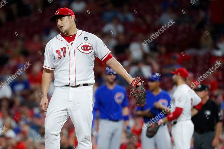 Stock Picture of Cincinnati Reds' David Hernandez reacts after giving up a two-run single to Chicago Cubs' Kris Bryant during the seventh inning of a baseball game, in Cincinnati